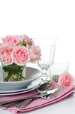 Festive table setting with pink roses Royalty Free Stock Images