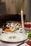 Festive table setting, plate, glass and candle Royalty Free Stock Photo