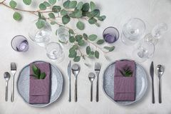 Festive table setting with plates, cutlery and napkins on light background stock photos