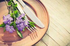 Festive Table setting with purple flowers. Royalty Free Stock Photos