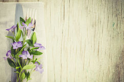 Festive Table setting with purple flowers. Stock Photography
