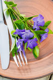 Festive Table setting with purple flowers. Royalty Free Stock Photo