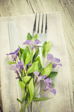 Festive Table setting with purple flowers. Stock Photo