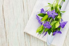 Festive Table setting with purple flowers. Festive Table setting with delicate purple flowers. Holiday Table Set for Mother`s Day or Birthday. Selective Focus Stock Photos
