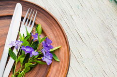 Festive Table setting with purple flowers. Royalty Free Stock Photography