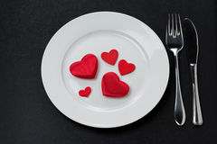 Festive table setting with red hearts Royalty Free Stock Images