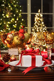 Festive table setting with red ribbon gift Royalty Free Stock Images