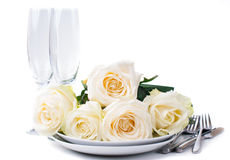 Festive table setting with roses Stock Photo