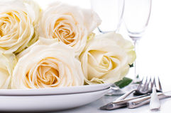 Festive table setting with roses Stock Photos