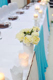 Festive table setting with roses in bright colors  Royalty Free Stock Photos