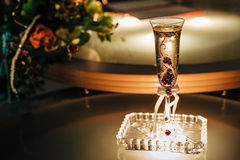 Festive table setting with roses in dark colors Royalty Free Stock Images
