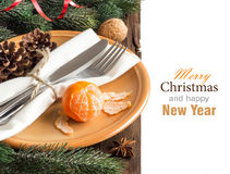 Festive table setting with spices and tangerine Stock Images