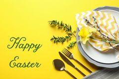 Festive table setting and text happy Easter on color background. Top view stock images