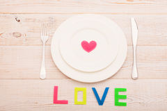 Festive table setting for Valentine Day. Word love. Beautiful Royalty Free Stock Photos