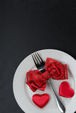 Festive table setting for Valentine's Day on a black background Stock Images