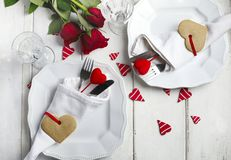 Festive table setting for Valentine`s Day with cutlery and gift Stock Photography