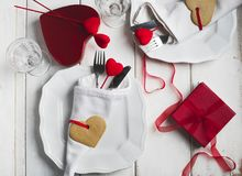 Festive table setting for Valentine`s Day with cutlery and gift Stock Photo