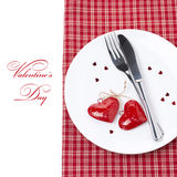 Festive table setting for Valentine's Day with fork, knife. And hearts,  on white Stock Photography