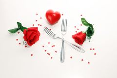 Festive table setting for Valentine`s Day with forks and hearts.  stock photos