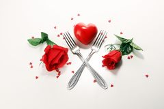 Festive table setting for Valentine`s Day with forks and hearts.  royalty free stock photography