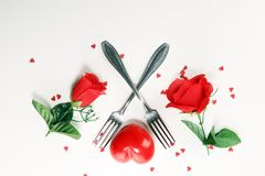 Festive table setting for Valentine`s Day with forks and hearts.  royalty free stock photos