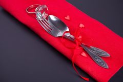 Festive table setting for Valentines Day with red napkin and cutlery stock image