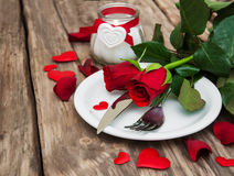 Festive table setting for valentines day. Festive table setting with red roses for valentines day Stock Images