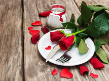 Festive table setting for valentines day. Festive table setting with red roses for valentines day Stock Photos