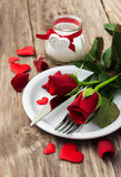Festive table setting for valentines day. Festive table setting with red roses for valentines day Stock Photo