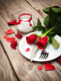 Festive table setting for valentines day. Festive table setting with red roses for valentines day Royalty Free Stock Photos
