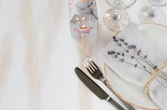 Festive table setting with candles and lavender. Festive table setting at vintage or provence style with candles and lavender. Concept Birthday, Valentine`s Royalty Free Stock Images