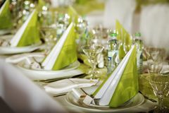 Festive table setting. For wedding, Valentine or other event ( Empty place cards on the white festive table Stock Photos