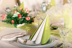Festive table setting. For wedding, Valentine or other event ( Empty place cards on the white festive table Royalty Free Stock Photography