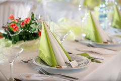 Festive table setting. For wedding, Valentine or other event ( Empty place cards on the white festive table Royalty Free Stock Photo