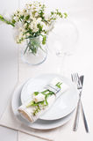 Festive table setting in white. Festive table setting and decoration with fresh flowers in white colors Royalty Free Stock Photos