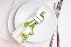 Festive table setting in white. Festive table setting and decoration with fresh flowers in white colors Stock Photos