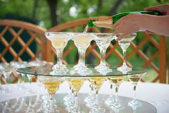 Festive table setting wineglasses with champagne.  Royalty Free Stock Photo
