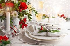 Free Festive Table Setting With Winter Flower Arrangement On Table Decorated For Holiday. Christmas Or New Year Dinner Concept.. Stock Photography - 199949212