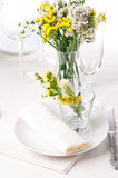 Festive table setting in yellow Stock Images