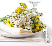 Festive table setting in yellow Stock Photo