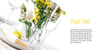 Festive table setting in yellow, template. Festive table setting and decoration with fresh yellow flowers Royalty Free Stock Photography