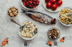 Festive table tasty. The dishes on the table in the eve of the feast, delicious food Royalty Free Stock Photography