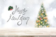 Festive table top background in snowfall royalty free stock photography