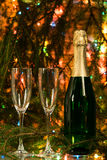 On a festive table wine and two glasses. Closed champagne bottle and two empty glasses Stock Photography