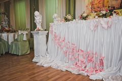 The decoration of the festive table cloth and flowers. Festive tables decorated with cloth and flowers Royalty Free Stock Images