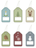 Festive tags. Christmas tags with festive motifs Stock Images
