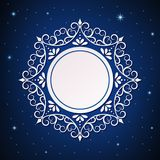 Festive template, snowflake, frame for New Year and Christmas. White festive frame, mandala, snowflake on a blue background with stars. Template for New Year`s Royalty Free Stock Photo