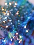 Festive texture in delicate turquoise and purple hues with colorful beautiful bokeh and multi-colored spots royalty free stock photography