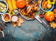 Festive Thanksgiving Day food background with roasted whole turkey or chicken and sauce, harvest vegetables royalty free stock photo