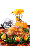 Festive Thanksgiving Dinner. Thanksgiving turkey dinner with fresh fruit, dishes and flowers